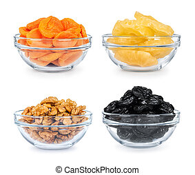 collection of dried fruit in a glass bowl on a white...
