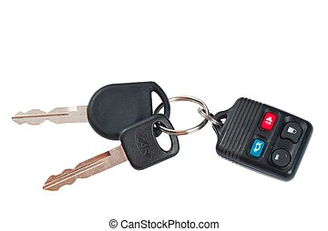 close up shot of plastic car keys and remote control on white ba