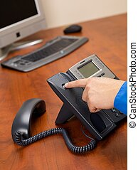 human hand disconnecting landline phone