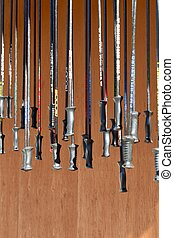 ski poles hanging in a row