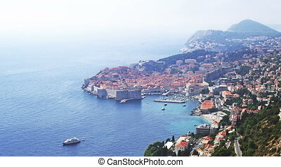 Telephoto lens panorama of Dubrovnik old town. Summer time.
