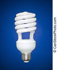 Fluorescent light bulb over blue - Compact fluorescent light...
