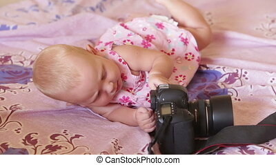 child in dress lay on the bed - child in pink dress lay on...