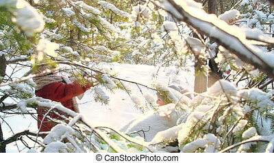 Snowdust - Through the pine tree branches shot of kids...