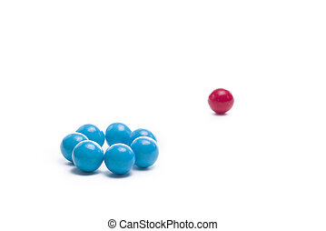 Left Out of a Group - Group of gumballs symbolizing...
