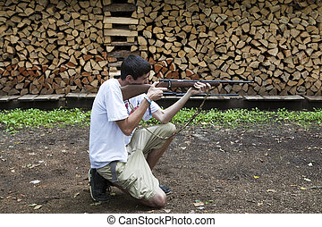 Target Practice - Young hunter practicing his shot with a...