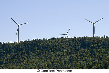 Wind turbines sprouting from the forest - Wind turbines in...