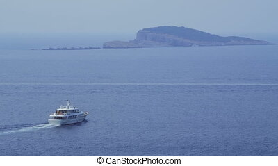 Panorama of Dubrovnik waters with yacht passing by
