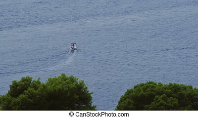 Panorama of Cavtat waters with boat passing by Dubrovnik...