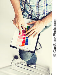 man with color samples for selection - interior design and...