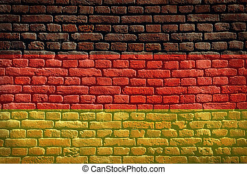 German flag background on a brick wall