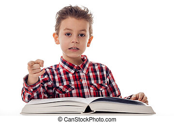 Boy with book pointing - portrait of a young boy in shirt...