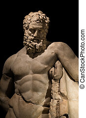 A statue of powerful Hercules, closeup, isolated in black,...
