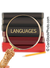 Looking in on education - Languages - Magnifying glass or...
