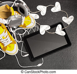 Love for music concept. Yellow sneakers, headphones,...