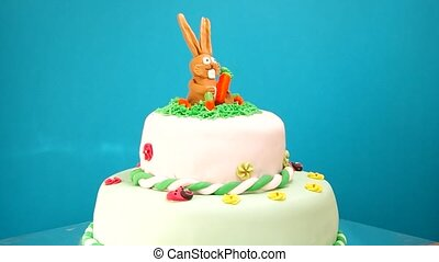 Childrens birthday cake on blue background