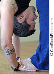 Hastapadasana - Malke yogi. Hastapadasana is the yoga pose...