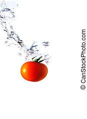 red tomato splashing in water