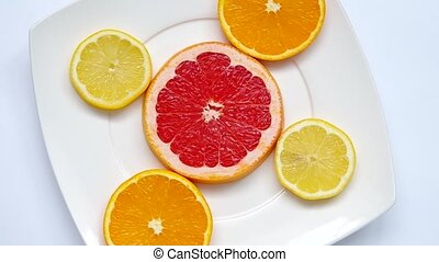 Sliced grapefruit, orange and lemon - Sliced...