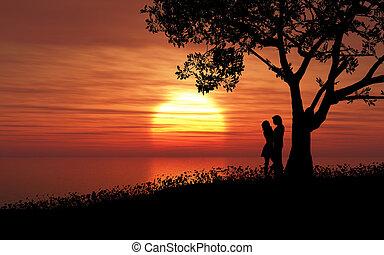 Couple against a sunset sky