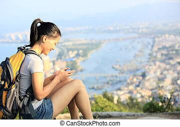 woman hiker use digital tablet - young asian woman hiker use...
