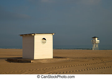 Beach hut - Small beach hut and lifguard tower on a sandy...