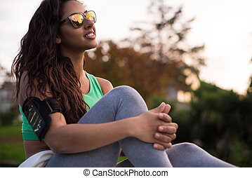 Fitness woman - Fitness runner woman relaxing in the city...