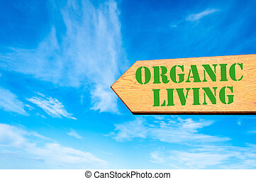 Arrow sign with Organic Living message