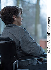 Older woman - Image of older injured woman sitting on a...
