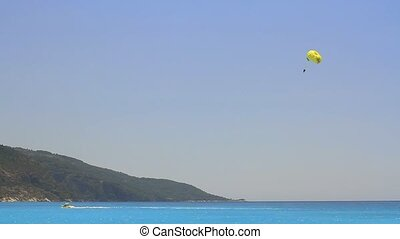 Tourist para sailing over the blue sea at Oludeniz. Summer...
