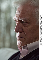 Depression in old age - Portrait of man having depression in...