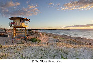 Wanda Lifeguard Tower in summer - Early summer morning at...