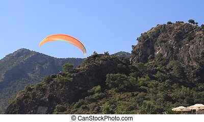Paraglider maneuvering parachute - Paraglider maneuvering...