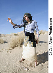 Young oracle woman gesturing in the desert.