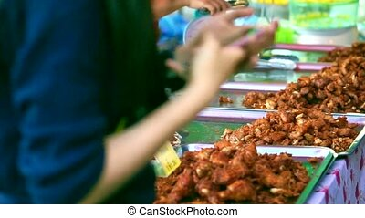 selling fries street food in Asia