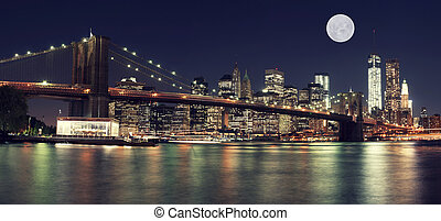 New York Skyline at night with Moon - Brooklyn Bridge and...