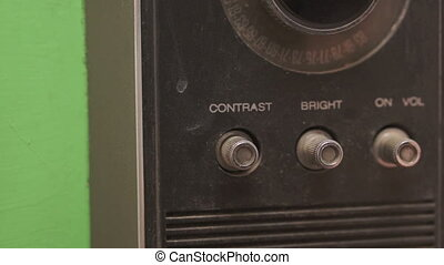 Adjusting Brightness on a Retro TV - Close up shot of the...