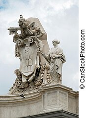 Sculptures on the facade of Vatican city works. Rome. Italy.