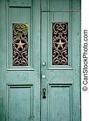 Old green door - Green old wooden door in French Quarter,...
