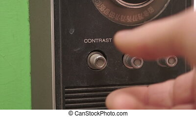 Adjusting Contrast on a Retro TV - Close up shot of the hand...