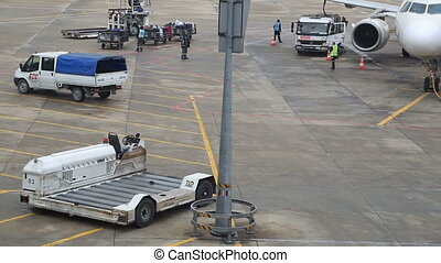 Luggages loaded onto an airplane - Airplane being loaded and...