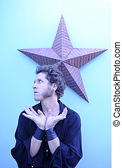 Star Man - Portrait of a man with a star background.
