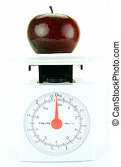 Healthy Living - A red apple on top of a set of kitchen...