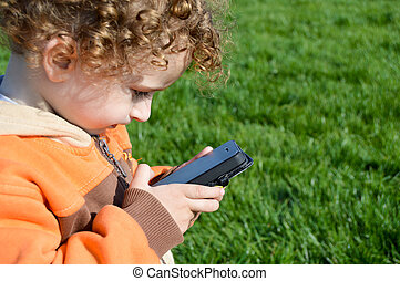 cute kids - A cute children playing with mobile phone