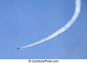 Air show - Plane on an air show against blue sky