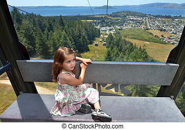 Young girl travel on Skyline Gondola - Young girl age 04...
