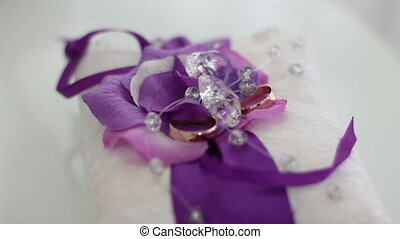 wedding rings on a cushion - beautiful wedding rings on a...