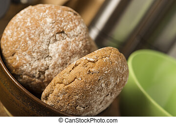 Fresh brown wholewheat rolls in a bowl