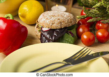 Healthy Burger Beside Fresh Ingredients and Plate