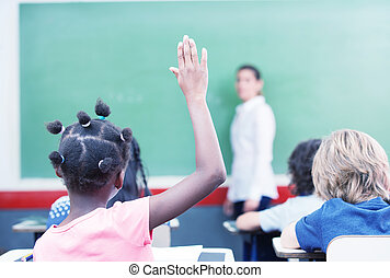 Afroamerican female student raising hand at school.